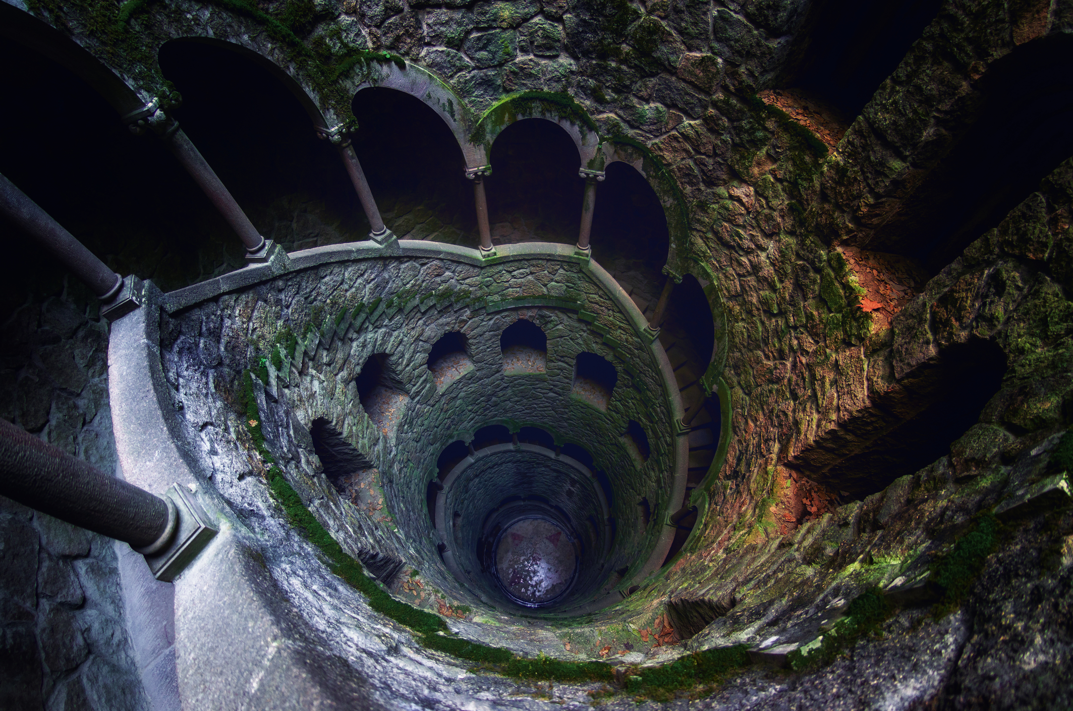 The famous initiation well of the Quinta da Regaleira, masonic spiral staircase of the romantic age in Sintra, Portugal, on February 5, 2019